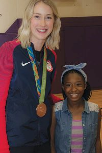 Last month, Olympic bronze medalist Kim Hill returned to Portland Christian Jr./Sr. High School, where she was a part of three state championship teams: two in volleyball and one in basketball. She poses with eighth-grader Jenaya Ballard, a big fan. STAFF/2016
