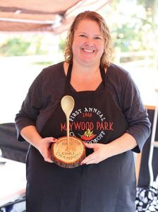 """Angie Merwin cooked up a batch of her """"Good Ol' Chili"""" and took home the winning trophy at the inaugural Maywood Park Chili & Cornbread Cook-Off held last month. COURTESY MARY CRESSLER"""