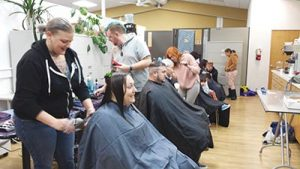 Bishops Barbershops' hip stylists help folks look their best for the season with free haircuts during the Impact NW Holiday Hope Drive last month. COURTESY IMPACT NW