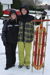 Haley Harmon and Cody Wood found the hills of Argay Terrace perfect for sledding. STAFF/2016
