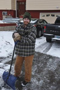East Portland residents shovel the sidewalks in front of their homes for safety. STAFF/2016