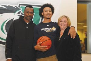 Parkrose Senior Isaac Bonton secured a full-ride scholarship to play basketball at Montana State University in Bozeman, Mont. The school has been recruiting him since elementary school. Bonton poses with parents Richard and Laura at his letter of intent signing ceremony held at Parkrose. STAFF/2016