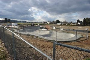 In addition to a security fence around the Luuwit View Park construction site, a second fence went up around the skate park site as skateboarders began using it on weekends shortly after it was completed last fall. The 16-acre park in Argay Terrace is set to open this fall. STAFF/2017