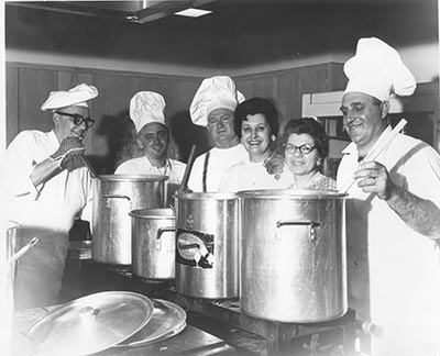 St. Rita Catholic Church is cancelling its annual spaghetti dinner after 80 years due to a dearth of volunteers. This group of dedicated chefs from the 1960s is, from left, Joe Jacko, Jim Pitton, Joe Wagner, Marguerite Cereghino, and Rose and Bert Garre. Simmering tomato sauce had St. Rita Catholic Church smelling like an Italian café for weeks before the annual spaghetti dinner. COURTESY ST. RITA CATHOLIC CHURCH