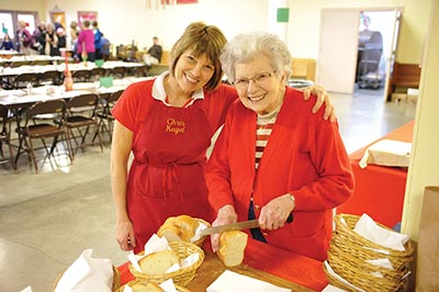 Chris Kugel and her mom, Rose Garre, pose at the 2012 dinner. Kugel said a lack of volunteers contributed to the 80-year-old dinner's death. STAFF/2012