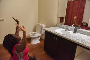One new tenant at Fern Grove Apartments at 143rd Avenue and East Burnside Street dropped to her knees in joy at the site of her spacious new bathroom. COURTESY PHC Northwest