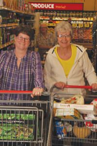 Until this month, when a Grocery Outlet opened in Parkrose, longtime Parkrose resident Jackie Means, right, had to go to Hollywood, where her friend Sheila Magby lives, to shop at a Grocery Outlet. Now they can shop together at either location. STAFF/2016