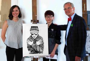 Portland Christian visual arts instructor Sarah Whitley, left, and U.S. Representative Earl Blumenauer admire the work of Yimin (Tyler) Hu, a PCS student, whose work was selected to be displayed in the Capitol building in Washington D.C. for the next year. COURTESY SHEILA TRETTER
