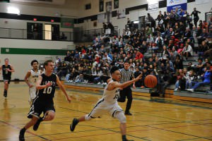 Sophomore guard Vincent Tran chases down a loose ball during Parkrose's 84-64 win over Sandy last month.