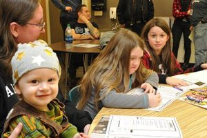 In November, Holly Nichols brought her children, from left, Ulysses, Drake and Lucia, to the first After School Satan Club in the nation held at Sacramento Elementary in the Parkrose School District. STAFF/2016