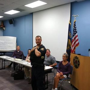 Jason Jones, district police officer in Parkrose for the last four years, is leaving east Portland to enter the Behavioral Health Unit, where he'll be working as a crisis intervention team coordinator. He is pictured at a Argay Terrace Neighborhood Association meeting in 2015. STAFF/2015