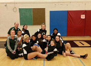 Bronco volleyball players, with their trophy, won second place at a Madison High tournament. COURTESY BREANNA MARKHAM