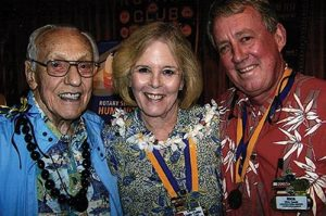 Ollie Lund, left, poses with Linda Coble and Rick Towill of the Honolulu Rotary Club. The Honolulu club, chartered in 1915, is Hawai'i's oldest and largest. COURTESY OLLIE LUND
