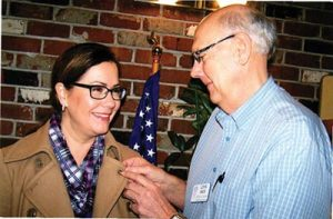 Laurie Fowlkes, development director for Portland Christian Schools, receives her Rotary emblem from John Ward at the Northeast Rotary Club's weekly meeting. She is in the midst of a capital fundraising effort to build a new gymnasium at the high school. Northeast Rotary club meets Tuesdays at noon at Kings Omelets, 10711 N.E. Halsey St. COURTESY OLLIE LUND
