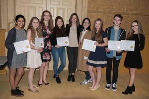 Portland Christian Portland Metro Scholastic Art and Writing gold key recipients accept their awards at a ceremony at the Portland Art Museum. They are, from left, Suzanne Hollingsworth, Allison Brist, Annie Bahr, Jimin Oh, Sarah Whitley (visual arts teacher), Anissa Chak, Lydia Mumford, Matthew Griffith and Katherine Fakashchuk. COURTESY BETH MUMFORD