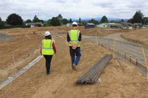Project manager Britta Herwig surveys the construction site with her crew. Photo by Ygal Kaufman