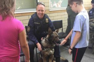 Five-year-old Jasco, a German Shepherd K-9 patrol dog, and his human partner, Officer Shawn Gore, were most popular with youngsters during last month's open house at the East Precinct. COURTESY KAREN LAVOIE