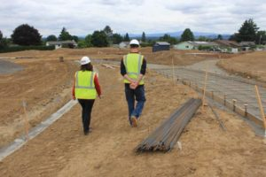 Project manager Britta Herwig surveys the construction site with her crew.
