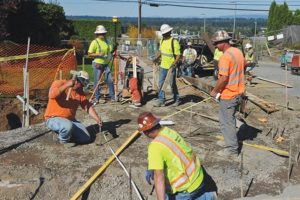 Crews from Stacy and Witbeck, a civil contactors firm helping build the new Luuwit View park, construct new sidewalks and street on Northeast 125th Avenue for one of the main entrances to the new park that is set to open Saturday, Oct. 21. STAFF/2017