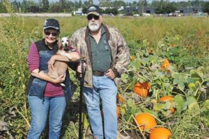 In addition to their produce and berry stand at 5905 N.E. 158th Ave. (off Sandy Boulevard), Spada Farms opened a pumpkin patch in October. Modern farmers Ron Spada and Jeanette Tobie pose with Sable, their 14-year old dachshund, in their eight-acre pumpkin patch. For more information about what's in season and pumpkin pricing, call 503-539-5396. For the rest of the story, see Business Memos. STAFF/2017