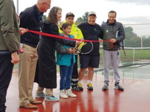 Arabella Toncinich cuts the ceremonial rope, opening the refurbished tennis courts at Argay Park. STAFF/2017