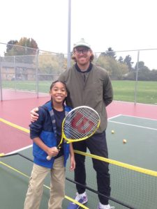 At the reopening of the refurbished Argay Park tennis courts, Portland Tennis Center's Chris Mulcahy poses with a novice player. COURTESY PORTLAND PARKS & RECREATION