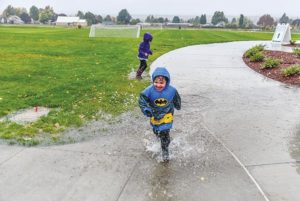 Some amenities park planners didn't plan for, like playing in puddles. COURTESY PORTLAND PARKS & RECREATION