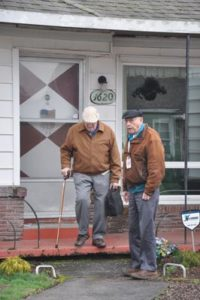 Volunteer Charlie Morris, right, helps Waldo Johnson to the car so he can get to his volunteer gig. COURTESY RIDE CONNECTION