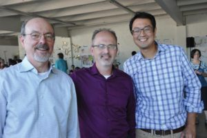 Posing at a recent 82nd Avenue Improvement Coalition meeting are, from left, Sera Design Principal Tim Smith, 82nd Avenue Improvement Coalition Chair Brian Wong, and Asian Pacific American Network of Oregon (APANO) Associate Director Brian Hwang. STAFF/2017