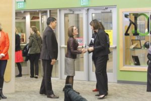 Governor Brown shakes hands with Principal Sweeney at Parkrose Middle School. STAFF/2017