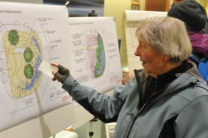Longtime east Portland resident Linda Allaway looks at proposed improvements for Windscape, the traffic roundabout at Northeast 102nd Avenue and Weidler Street, at an open house held last month. STAFF/2018