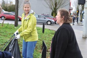 Last month, Rita Amdal (left) answered Sue Grimsrud's call on the internet for a little help to clean up the traffic jug handle at Northeast 102nd Avenue and Weidler Street. STAFF/2018