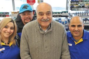 This month, Joe Amhaz, center, marks the 30th anniversary of his purchase of the am/pm minimarket and Arco gas station franchise at the corner of Northeast 122nd Avenue and Halsey Street. He poses with employees, from left, Marina Hanna, Israel Perez and Wajeh Somail. STAFF/2018
