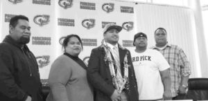 Flanked by family members, Parkrose's Spencer Tatafu, center, marks National Signing Day by committing to Idaho State University. COURTESY DAUNTE GOUGE