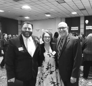 Last month, at SnowCap Community Charities' annual auction, SnowCap Volunteer Coordinator Nate Larsen, from left, poses with SnowCap Executive Director Kirsten Wageman and Parkrose Community United Church of Christ Pastor Don Frueh, who was the auction's Master of Ceremonies. COURTESY SNOWCAP