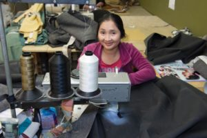 Like Mr. and Mrs. Castellano, seamstress Wah Muh, who has been with the Castellanos for five years, is also an immigrant. STAFF/2018