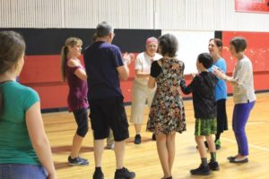 Christina White, co-owner of the Oregon Irish Dance Academy, calling a céilí dance at St. Therese. STAFF/2018