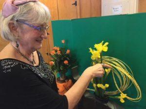 Villa Garden Club member Carole Schuldt, also a Designer's Guild member, uses mandolin sticks—the latest in flower design—for her arrangement at the club's 70th anniversary celebration. STAFF/2018