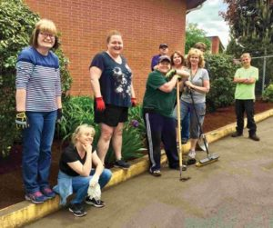 Last month, Parkrose School District office staff members volunteered to clean up the grounds around their office. COURTESY PARKROSE SCHOOL DISTRICT