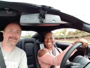 Parkrose High School Athletic Director Daunte Gouge and Joyce Brown take turns test driving a new car from Courtesy Ford to raise money for the school. COURTESY DAUNTE GOUGE