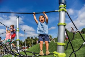 Elated children enjoy the new playground gear. COURTESY PORTLAND PARKS & RECREATION