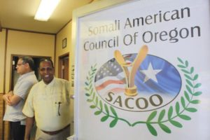 In June, the Somali American Council of Oregon, or SACOO, opened its first office on Southeast 122nd Avenue. SACOO primarily focuses on increasing the visibility of Portland's African community in a variety of different ways. Ali Diriye, SACOO Youth Program Manager poses next to the new sign. STAFF/2018