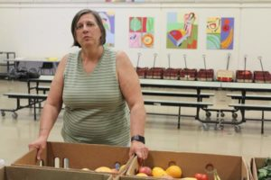 Many assume school pantries in public schools are only for the students and their families, but many are open to anyone in the community with few or no restrictions. Charlotte Davis runs pantries at Shaver, Lincoln Park and Sacramento Elementary schools. STAFF/2018