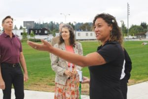 Marlene Zellars, with Portland Parks and Recreation, leads a tour of the new park facilities. STAFF/2018