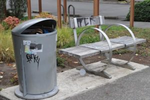 More trash cans and benches, like these in front of Riverview Bank, are set to be installed in the Gateway area. Sadly, vandals have been at work. STAFF/2018