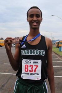Ahmed Ibrahim displays the third-place medal he won at the state championships at Lane Community College in Eugene. COURTESY PARKROSE CROSS-COUNTRY