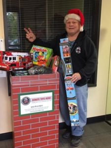 Doug Henderson makes a delivery of toys to Portland Fire & Rescue Toy and Joy Makers on behalf of the Parkrose High class of 1969. COURTESY TAMMY WILLET