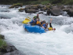 With no more monthly deadlines, the Currans will have more time for fun excursions like last summer's rafting trip on the Clackamas River. While Tim falls overboard waving hello (help), Darlene is on the left, staying in the raft. COURTESY OREGON RIVER EXPERIENCES