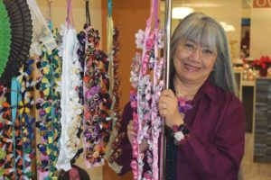 Flory Wold started Funky Flowers by Flory to sell handcrafted flower accessories from fabrics and buttons collected by her mother. STAFF/2018