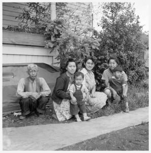 In 1915, Sukemon Itami opened Kern Park Floral. One hundred years later, his great-granddaughter and Hazelwood resident Holly Itami Springfels still operates the family business. Pictured outside their Portland home in May 1945 are Sukemon Itami, left, and members of his family. Springfels grandmother Fumi Itami, wearing glasses, is in the middle. COURTESY HIKARU IWASKI and UC BERKELEY, BANCROFT LIBRARY